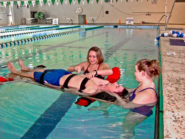 People in pool for CPR AED Class